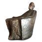 """Hanne Varming: """"Den altvidende"""". Figur af brunt patineret bronze. Sign. H. 49. D. 50."""
